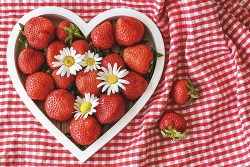 Heart shaped vessel with strawberries within it