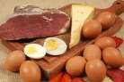 plate of meat, cheese, and eggs, which are all foods to avoid with high blood pressure