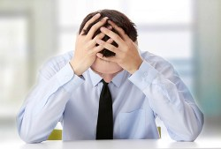business man clearly suffering from chronic fatigue syndrome
