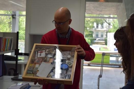 Florin Feneru with a draw of specimens for identification.  Photo credit: Aarti Bhogaita