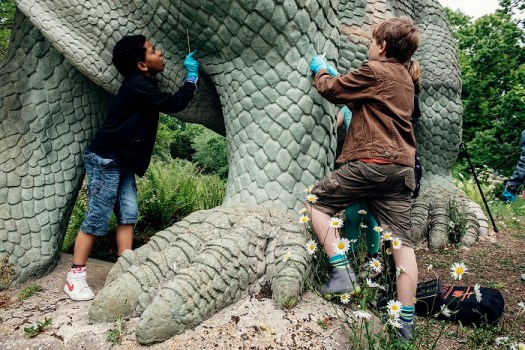 Transition kids collecting samples from the surface of one of the dinosaurs. © Stefan Ferreira