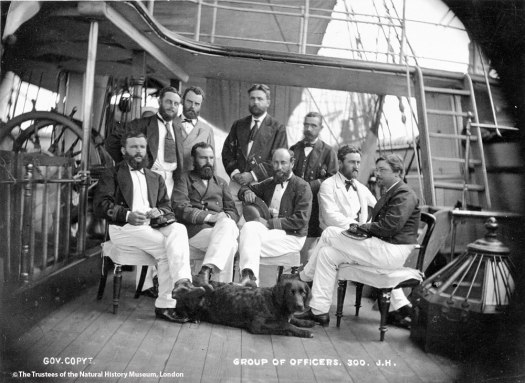 A black and white photo from the archives showing the officers seated not the deck of the ship