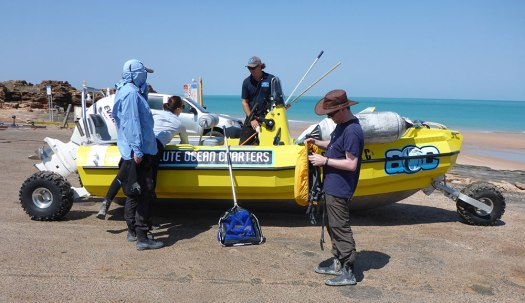 Photo of Bruno Simoes and team standing around the amphibious vehicle they used to explore mangroves