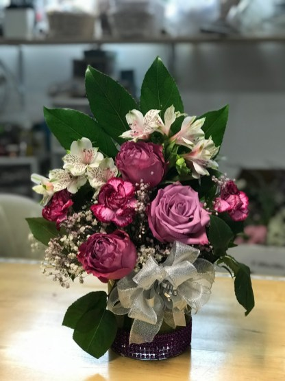 LVRE036- Pink roses, white carnations and baby breathe.
