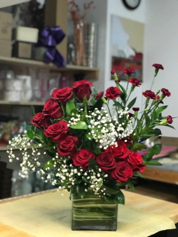 LVRE005-Rectangular glass vase with Red roses, red mini carnation and baby breathSpecial: $110.00