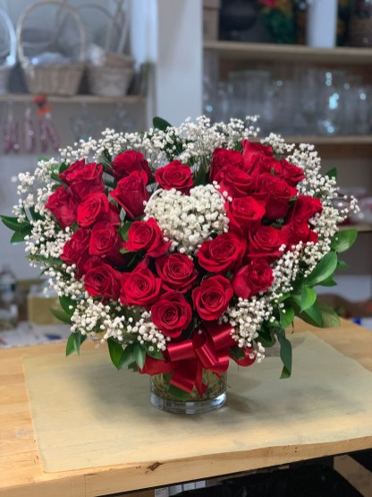 LVRE026- Heart-shaped arrangement with red roses and baby breathSpecial: $150.00