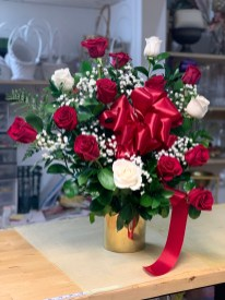 LVRE022- A dozen red roses with four white roses, baby breath and a big red ribbon.Vases come in gold and silver.Special: $120.00