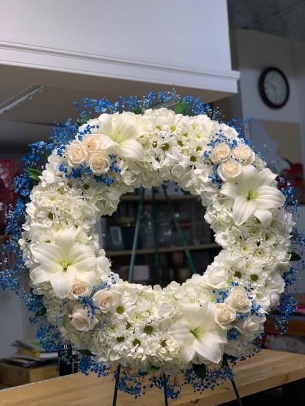 FNR021 White and vendela roses, white Lillies and blue baby breathe. $235.00