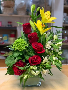 19)Yellow Lily& red roses hydranges and astromerias$65.00
