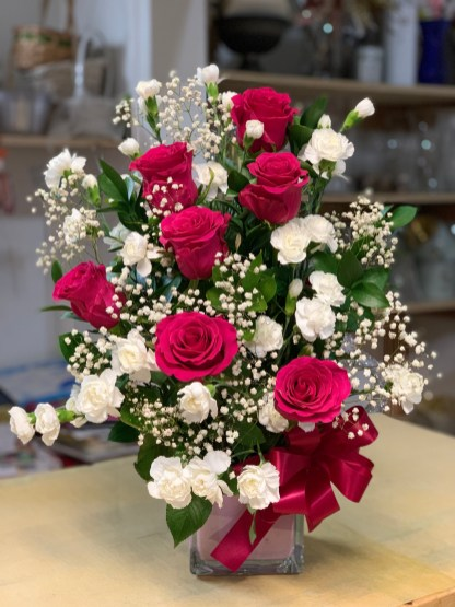 14)Gotchaa roses &white minicarnations $65.00