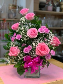 7) Pink roses & minicarnations $60.00