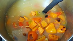 Roasted vegetables add to the prepared soup stock.