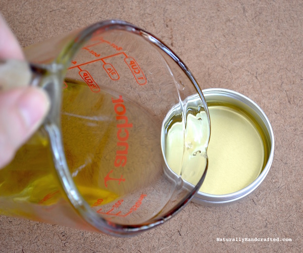 pour homemade muscle rub into container