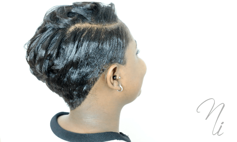 Pixie cuts of curls on white wall