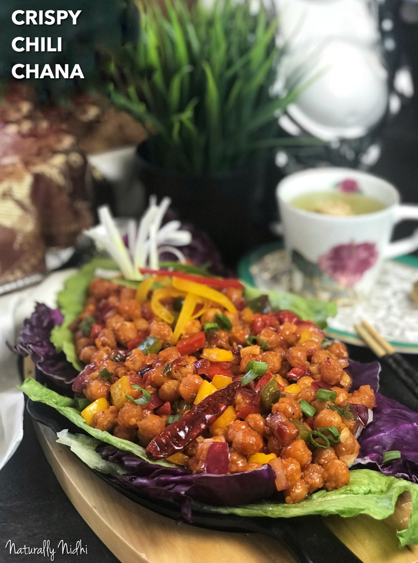 Crisped to perfection and glazed with the most gorgeous Asian-inspired sauce, this Crispy Chili Chana with crunchy vegetables and chickpeas is the most delicious appetizer ever!! Packed full of dynamic flavors, it is the perfect bold appetizer to start off a dinner party!