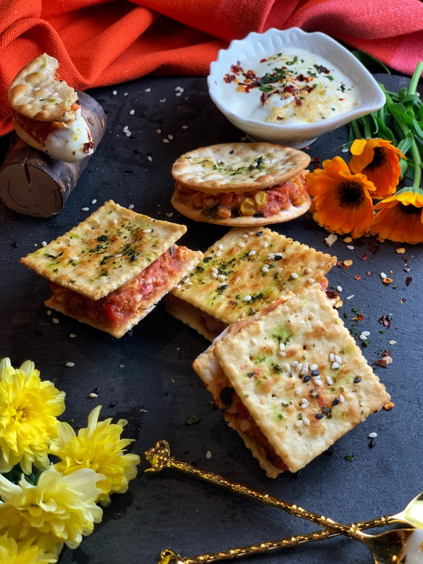 Baked Cracker Cutlets - a delightfully yummy cutlet made by sandwiching a vegetable melody filling between crackers, this easy appetizer is baked to perfection. Crispy, explosive, and vibrant, these are sure to be a hit at any party or gathering! Pair this with a tangy mustard aioli for an awesome appetizer!