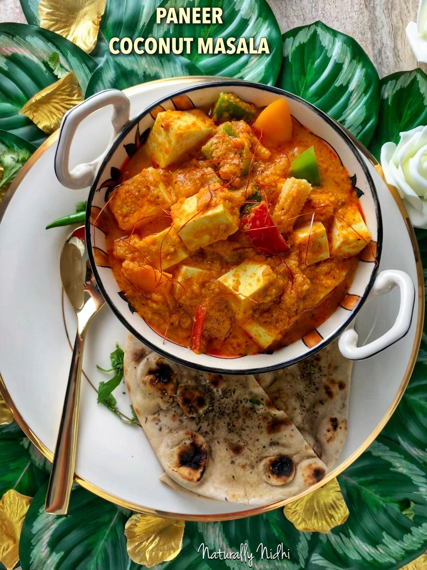 Paneer Coconut Masala - an Asian inspired twist on the timeless Indian classic, this paneer in coconut gravy is a harmonious blend of coconut milk and tomato, all at once. The crisp bell peppers, baby corn, and onions give it a lovely freshness and make it the perfect dish! Enjoy this with paratha, naan bread or rice!