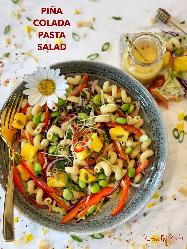 Enjoy the tropical, tangy flavor of a piña colada through this pasta salad with a fruity Hawaiian dressing, crunchy vegetables, and fresh pineapple chunks! The Pina Colada Pasta Salad also features delicious, fresh vegetables like cabbage, peppers, onions, and edamame that makes for a crunchy, protein-packed dish.