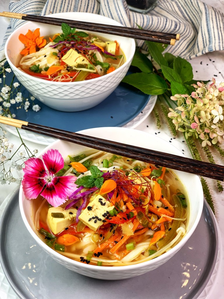 This vegan Golden Turmeric Citrus Ramen features miso paste, fresh turmeric root, lemon zest and cilantro infusion. Ladled over rice noodles with a medley of vegetables and tofu, it's a hearty, warming meal that's perfect for the colder weather!