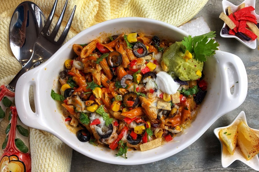 Enchilada Pasta Bake - dotted with colorful veggies, velvety pockets of cheese, and an array of vibrant spices, this baked vegetarian Mexican Pasta is the fusion dish of your dreams! There's no better way to spice up a pasta dish than adding in some homemade enchilada sauce for a fun twist!