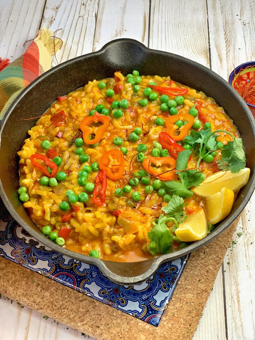 One-Pot Spanish Vegetable Paella - delicately flavored with saffron, paprika, and turmeric, this vegetarian paella is the perfect escape! Taste the vibrant vegetables and spices and bask in Spanish sun, all from the comfort of your home!