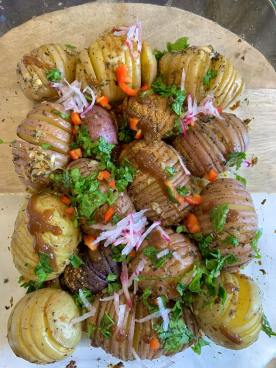 Crispy on the edges and fluffy on the inside, this hasselback potato chaat (Delhi style) is a delicious appetizer. Tangy and sweet from a homemade chaat masala, fresh radishes, and pickled onions, there's no better treat for your taste buds than these baked spicy potatoes!