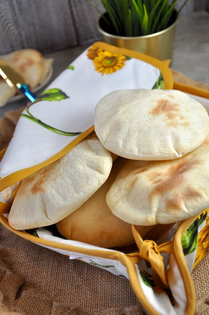 Deliciously soft and tender, these homemade Pita Breads are nothing short of heavenly! A super simple mix of pantry staples, whip these Mediterranean Pita breads up to use in sandwiches, wraps, and even as naan!