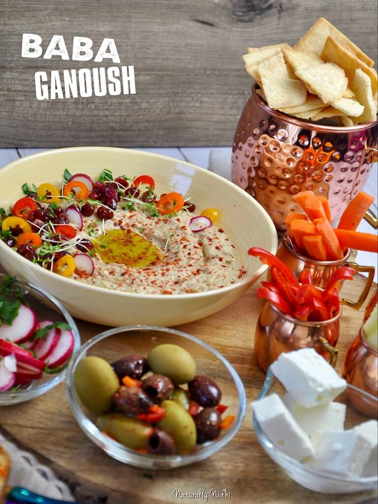 Irresistibly smooth and smoky, this homemade Baba Ganoush is the ultimate middle eastern dip! Pair it with a veggie platter and some fresh pita chips for a light lunch or snack that you can whip up in under 15 minutes!