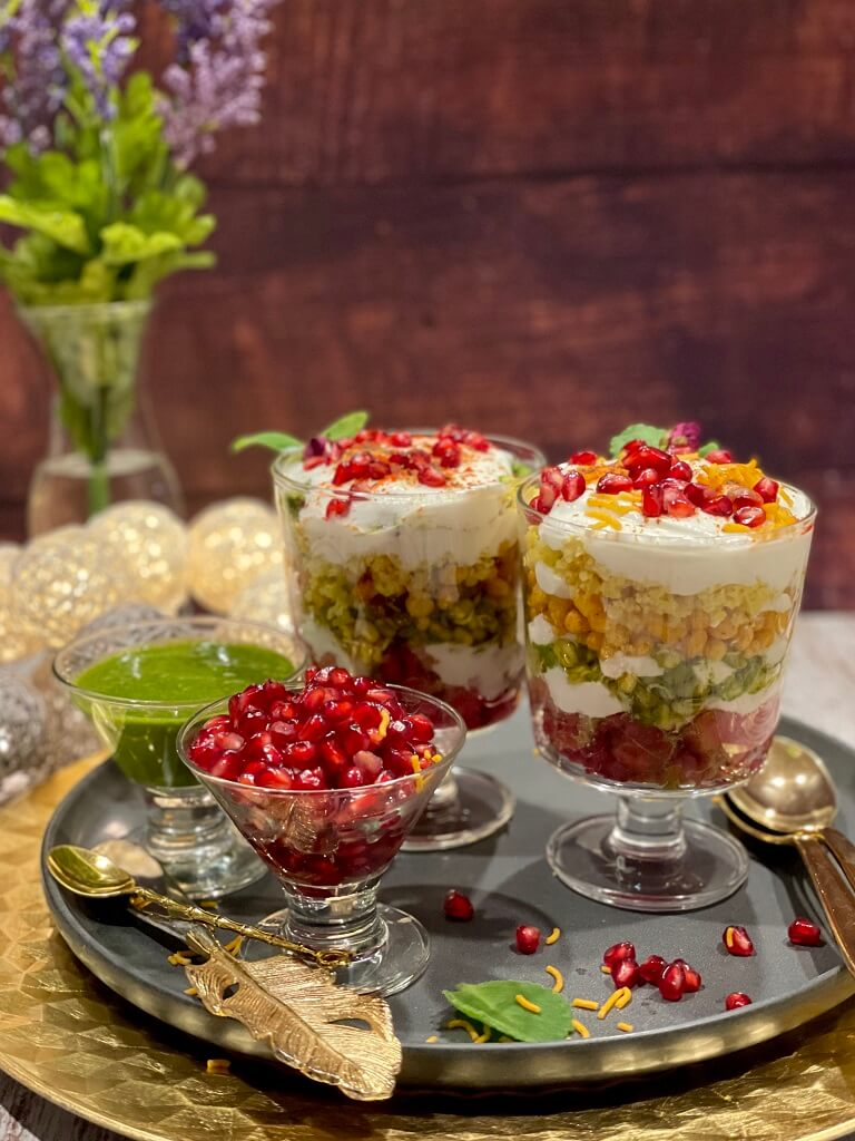 Seven Layer Dahi Chaat - with mung bean sprouts, fluffy dhokla, crunchy papdi, tangy boondi, masala potatoes, creamy yogurt, and sweet and spicy chutneys, this is street food at its best!