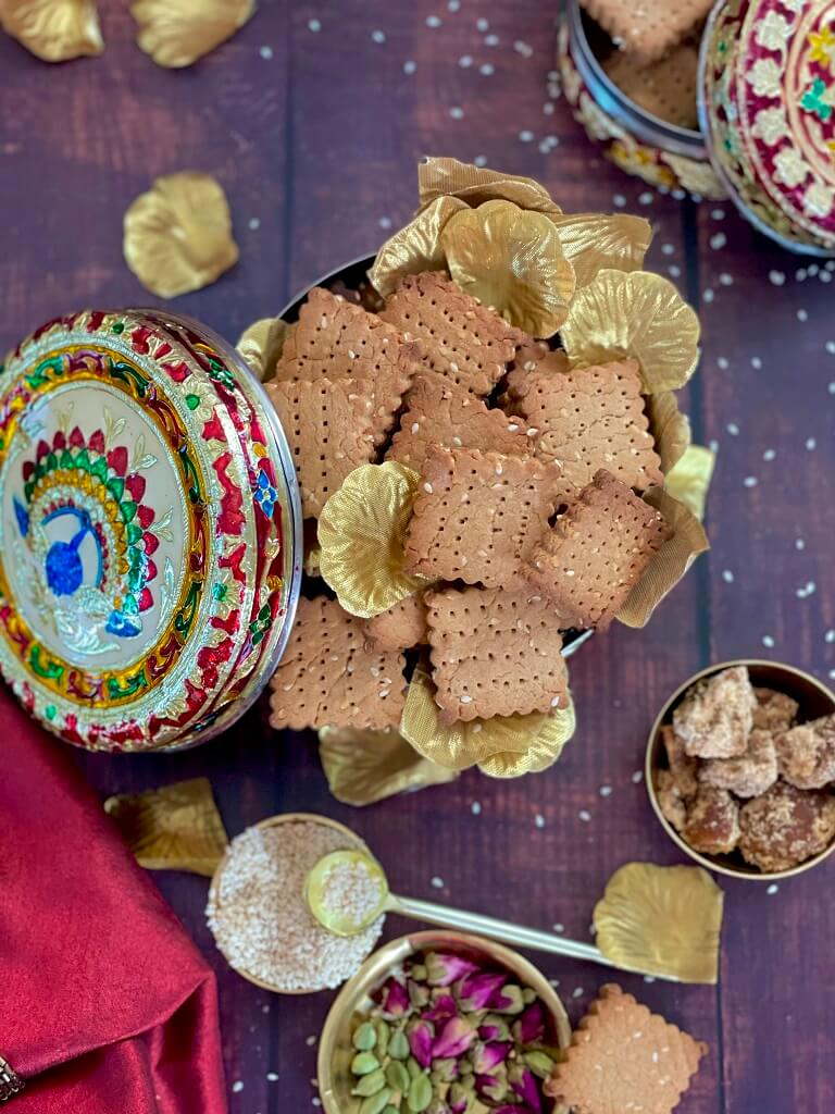 Baked Gur Para - crunchy and crispy, this healthy snack made with jaggery and whole wheat flour is popular throughout India. Baked to golden brown perfection and topped with sesame seeds, it's perfect for the festive season!