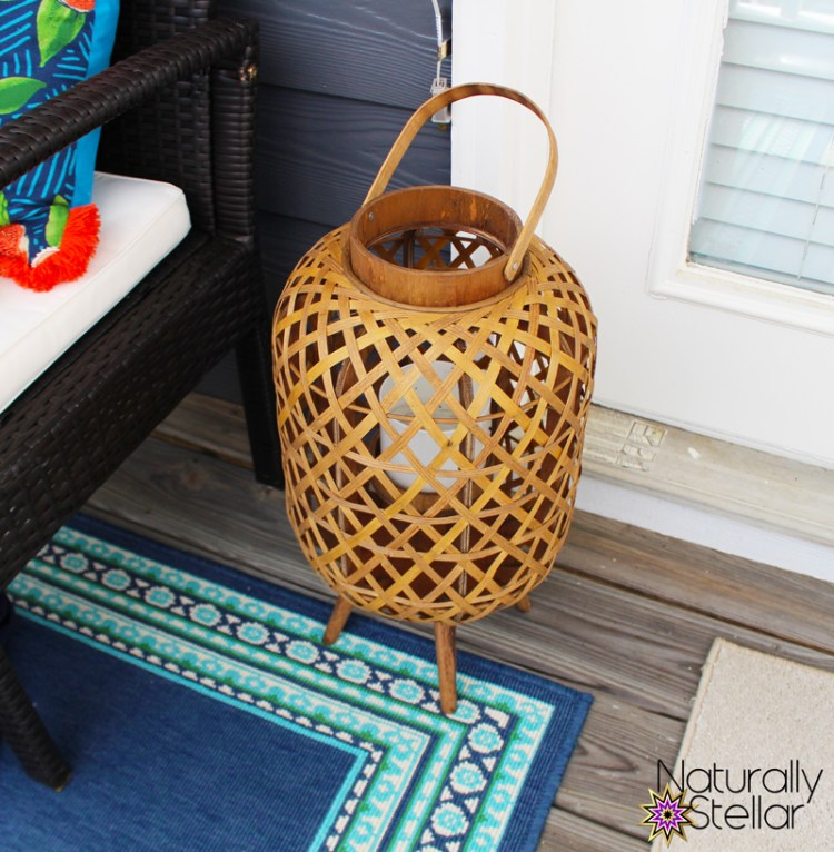 Tall wooden lantern as balcony decor