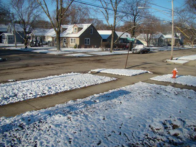 april snow on corner