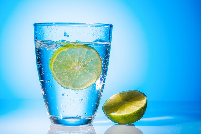 a glass of fresh drinking water and a lime. mineral water