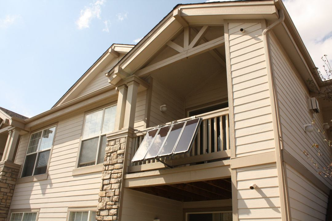 Solar panels attached to balustrade on the balcony of a rental home
