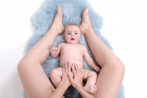 Baby massage is best performed on the floor. It's safer for baby and allows for close interaction.