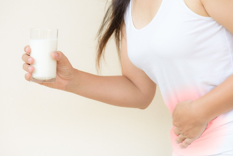 Woman Hand Holding Glass Of Milk Having Bad Stomach Ache Because