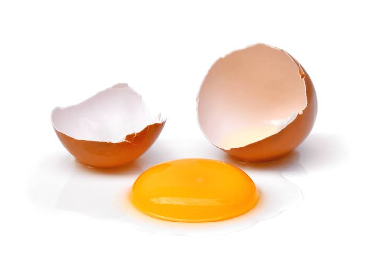 Cracked Egg With Egg Shell, Egg Yolk And Egg White