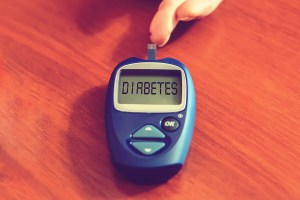 Diabetes Concept With Diabetes Medication On Wooden Desk