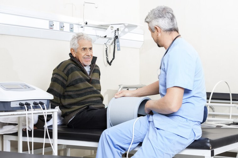 Senior Patient Receiving Electromagnetic Therapy