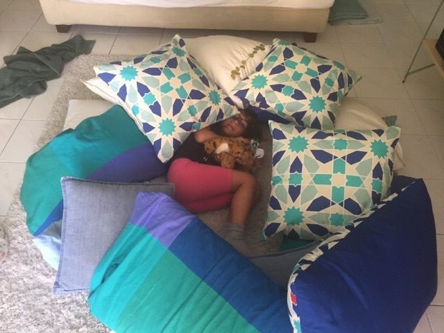 The girls had a lot of fun with all the pillows in the apartment.
