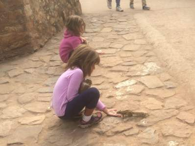 The girls preferred to feed popcorn to chipmunks than to see the sites.