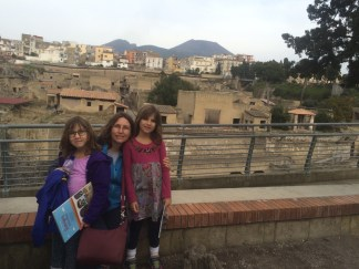 You can see the modern city on top of where the rest of Herculaneum is. That's Mount Vesuvius in the background.