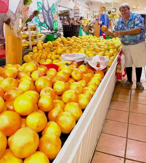 Jim Oleson of Boyett's Grove in Spring Lake will help you pick the finest fruit in his store.