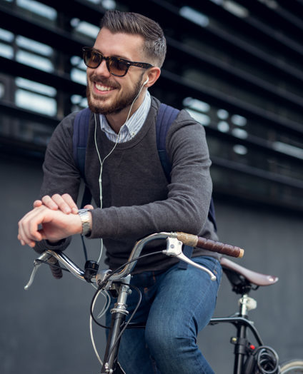 man smiling while resting on bicycle