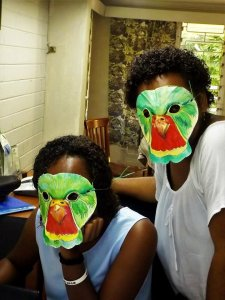 Two NatureFiji-MareqetiViti staff wearing Kulawai masks