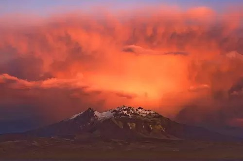 Volcano Cerro Colchane (Bolivia) at sunset