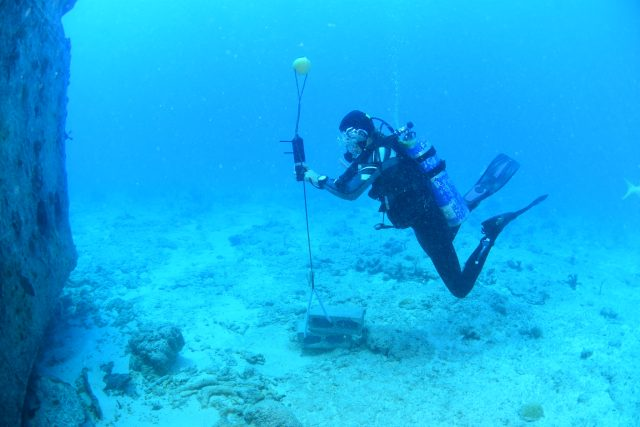diver at an underwater receiver