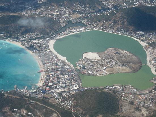 arial picture of philipsburg with a blue bay and grey salt pond