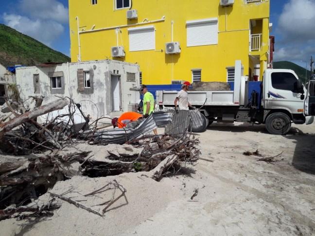 people clearing debris