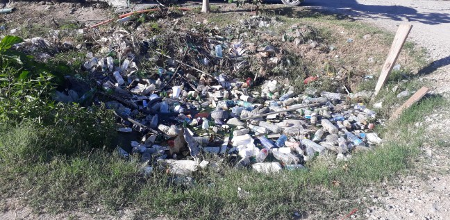 littered ditch full of plastic